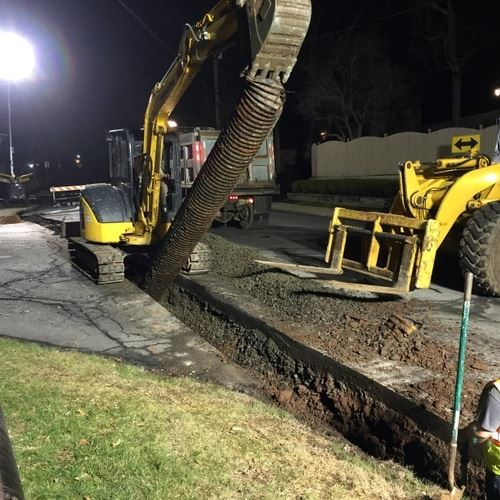 Excavator Pulling a Pipe out of the Ground